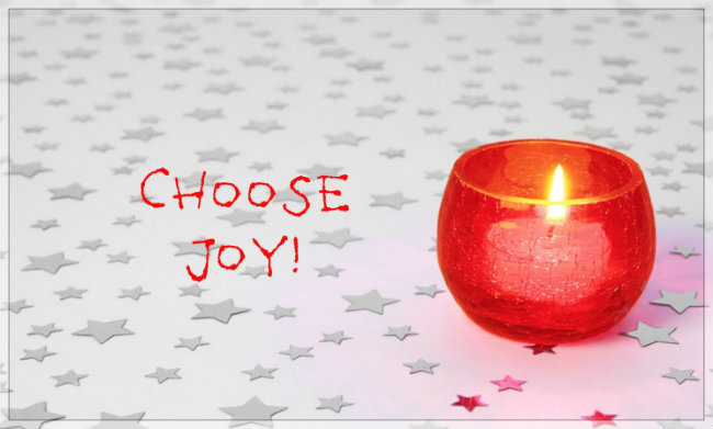 Choose Joy! In playful letters on simple poster of a red lit candle