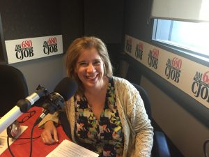 "Carolyn Klassen from Conexus Counselling sitting down at the microphone at 680CJOB in Winnipeg in her role as ""resident therapist"""