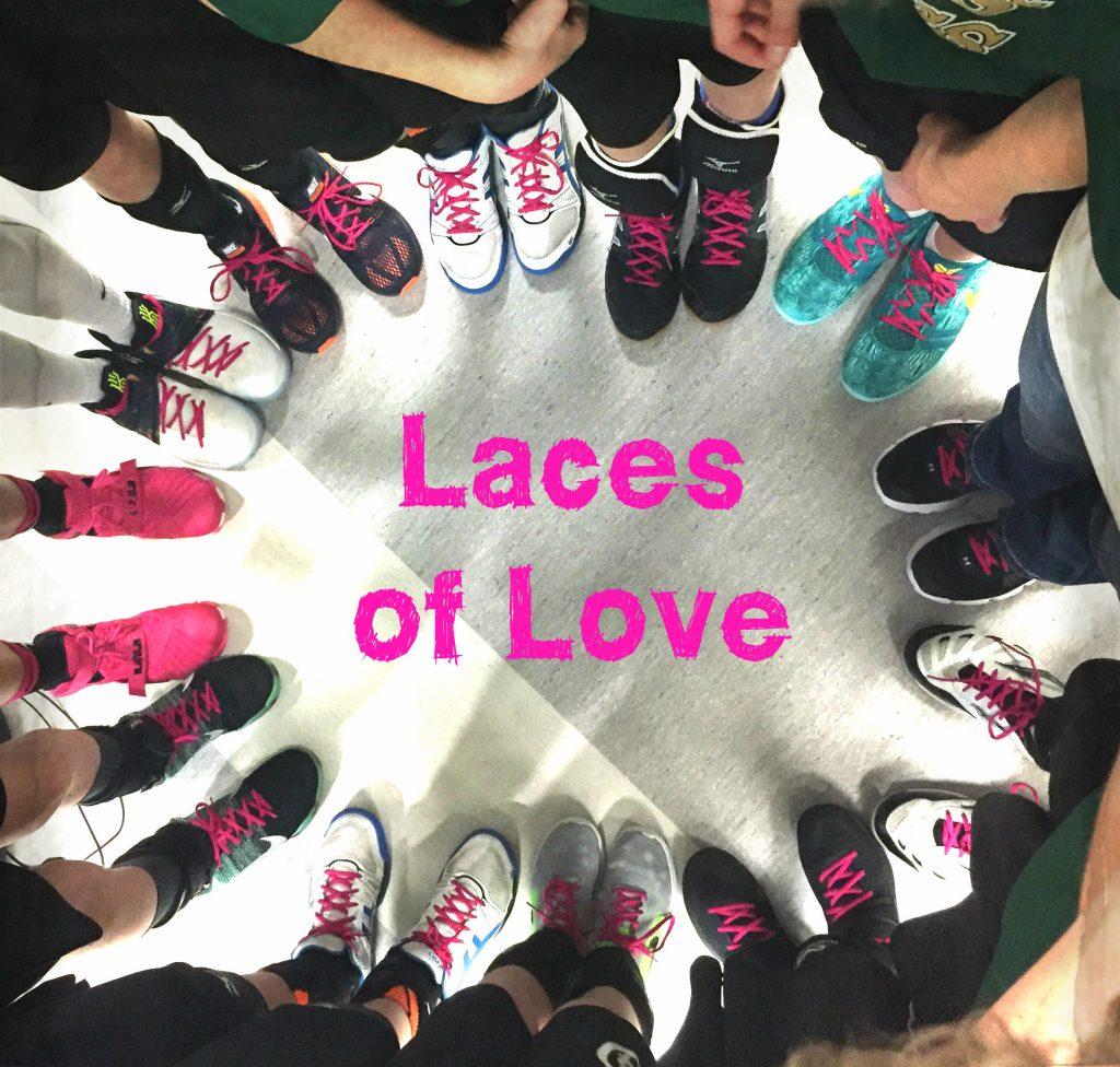 Love laces. Showing the love inside by wearing pink laces on their shoes. Loving their teammate through a symbol of support and honour for his mom.