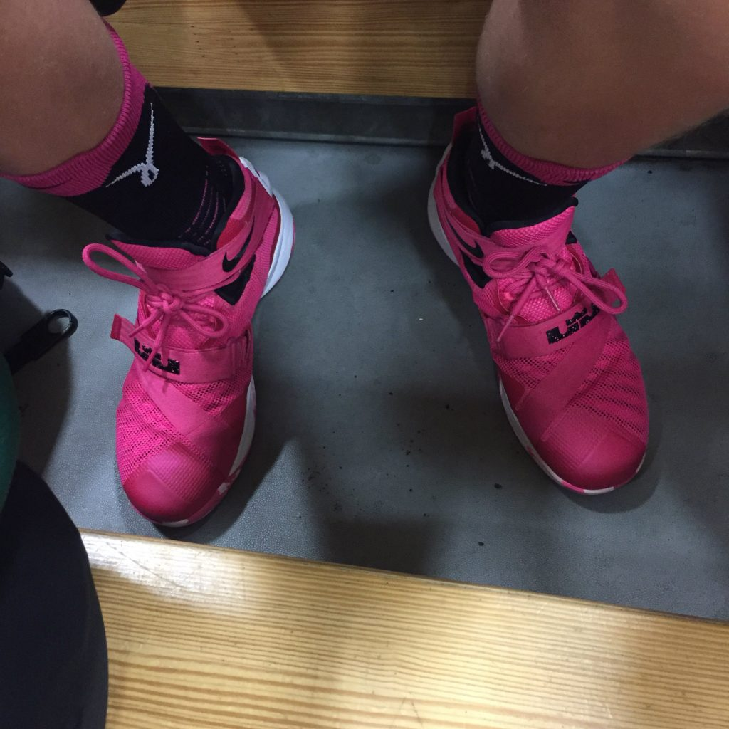 My Junior Tribe Member's fluorescent pink shoes
