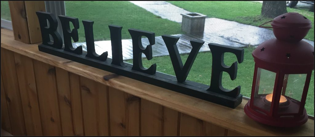 Believe with each letter cut out of wood