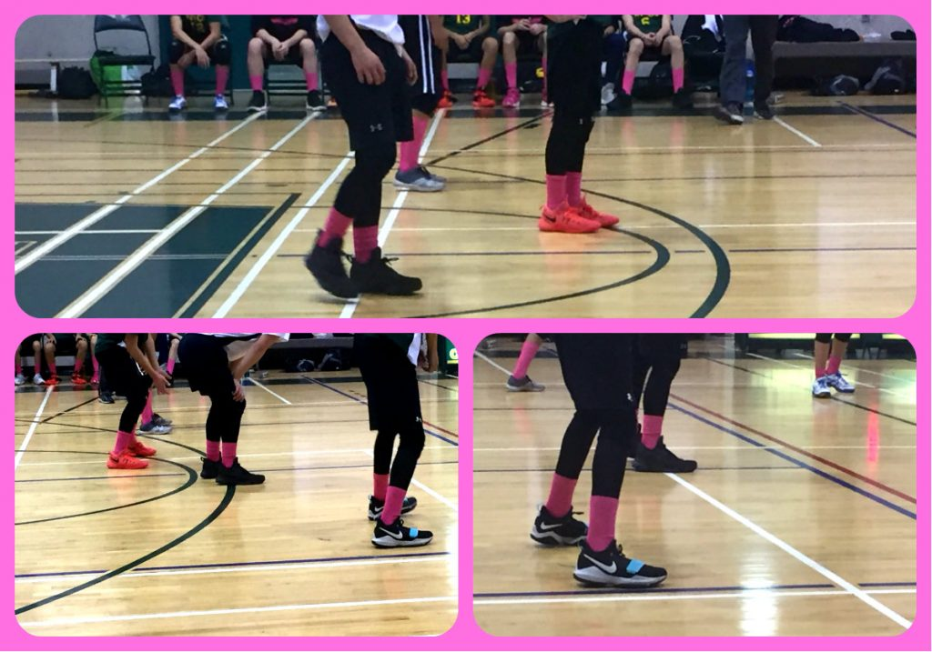 Volleyball court with athletes wearing pink socks in support of team member's mother who died of breast cancer.