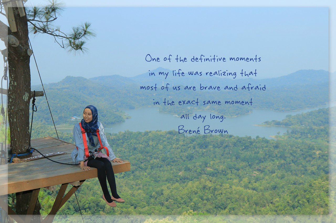 one of the definitive moments in my life was realizing that most of us are brave and afraid in the exact same moment all day long. Brené Brown quote on picture of a woman on an adventure platform. On blog about feeling big and different feelings: nevertheless