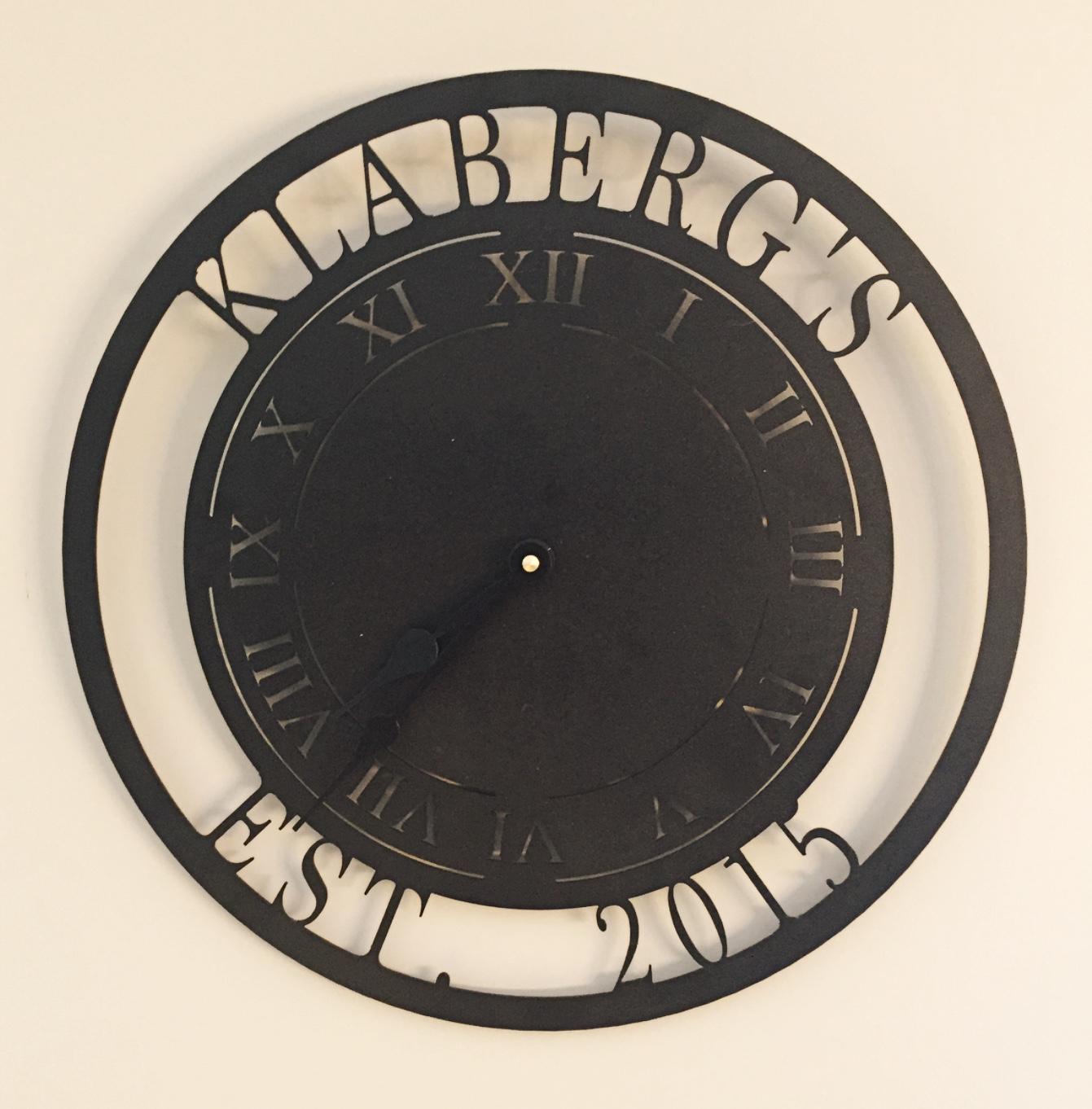 Metal clock with Klabergs 2016 around edges