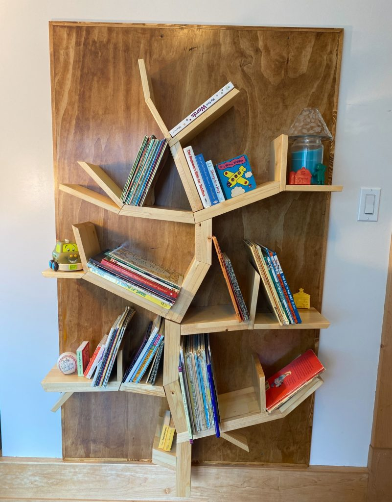 The bookshelf for our grandchildren's books handmade by Husband with wood in the shape of a tree